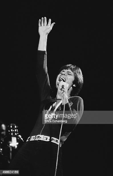 Cliff Richard performs on stage at the Royal Albert HallLondon December 1976