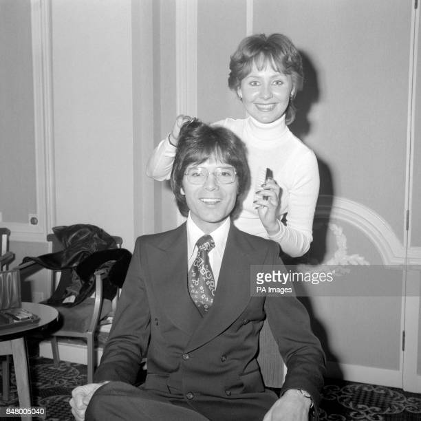 Cliff Richard with Lulu at the Waldorf Hotel London after winning the Head of the Year award from the National hairdressers' Federation for good hair...