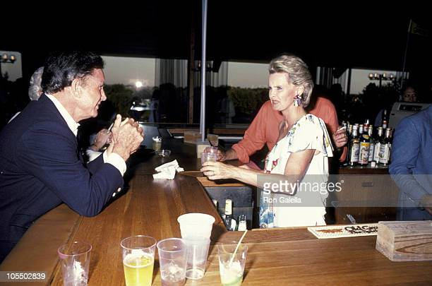 Cliff Robertson and Dina Merrill during Annual Scenery Greenery Benefit for the Montauk Village Association in Montauk Downs New York United States