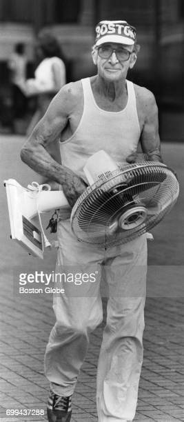 Cliff Walker of Boston holds the fan he purchased for a friend during a hot summer day July 1 1981