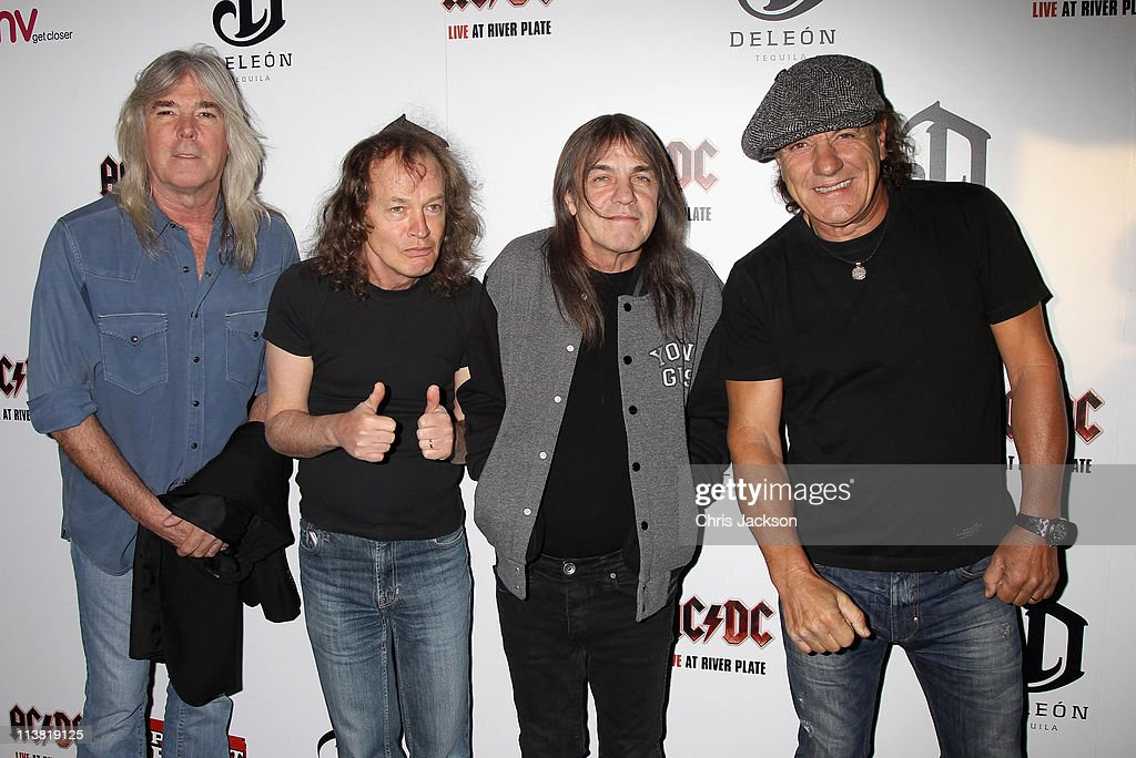 Cliff Williams, Angus Young, Malcolm Young and Brian Johnson of AC/DC arrive at HMV Hammersmith for the World Premiere of 'AC/DC Live at River Plate' Presented by DeLeón Tequila on May 6, 2011 in London, England.