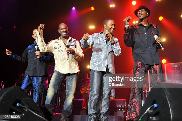Clifford Adams Robert Mickens Shawn McQuiller and Unidentified of Kool The Gang perform on stage during the 80's Rewind Christmas Tour at Wembley...