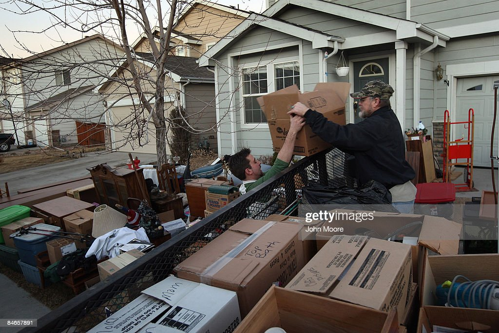 Clifford Coburn (R), loads his belongings onto a truck with the help of a neighbor after he and his mother were evicted from their foreclosed home February 3, 2009 in Brighton, Colorado. Coburn owned the home for two years, living there with his mother and earlier with his now ex-wife and her five children. He said that he was laid off from his telecommunications job, and when he got new employment late last year, it paid only half the salary. He got behind in his mortgage payments and the bank ordered his eviction.