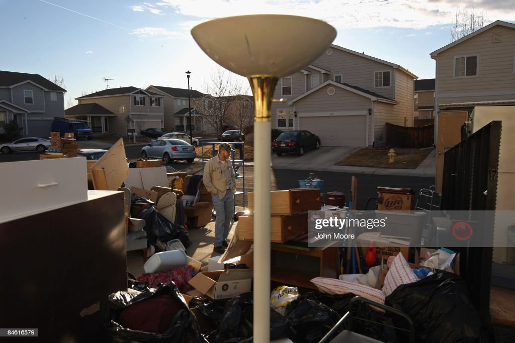 Clifford Coburn stands amidst his belongings in his front yard after he and his mother were evicted from their foreclosed home on February 3, 2009 in Brighton, Colorado. Coburn, who owned the home for two years, said that he was laid off from his telecommunications job, and when he got new employment late last year, it paid only half the salary. He got behind in his mortgage payments and the bank ordered his eviction.