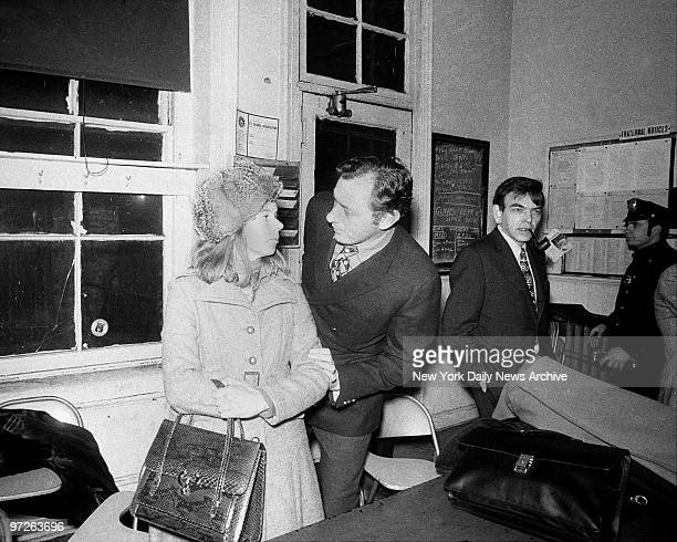 Clifford Irving consoles wife Edith in squad room of Elizabeth St police station after indictments by federal and county grand juries