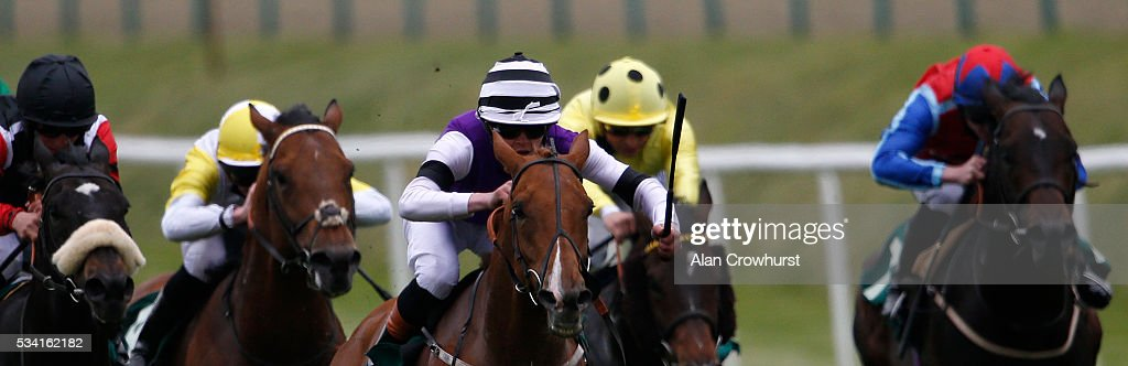 Clifford Lee riding Felix Leiter (C) win The martin Lawrence 60th Birthday celebration Handicap Stakes at Lingfield Park on May 25, 2016 in Lingfield, England.