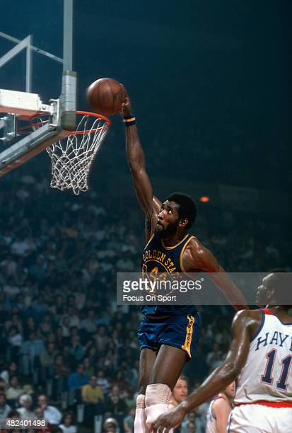 Clifford Ray of the Golden State Warriors slam dunks the ball against the Washington Bullets during an NBA basketball game circa 1975 at the Capital...