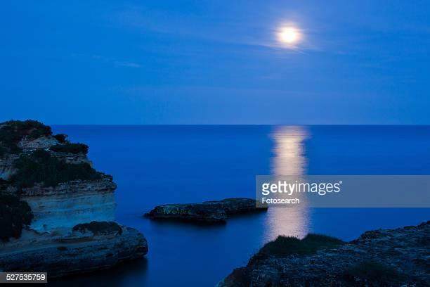 Cliffs and rocky coastline of Salento at twilight