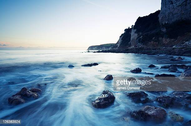Cliffs at Seaton Hole in Devon, England. Seaton's setting in the landscape is visually stunning and environmentally important. Seaton is a traditional Devon seaside town in the midst of an area of outstanding natural beauty midway between Lyme Regis