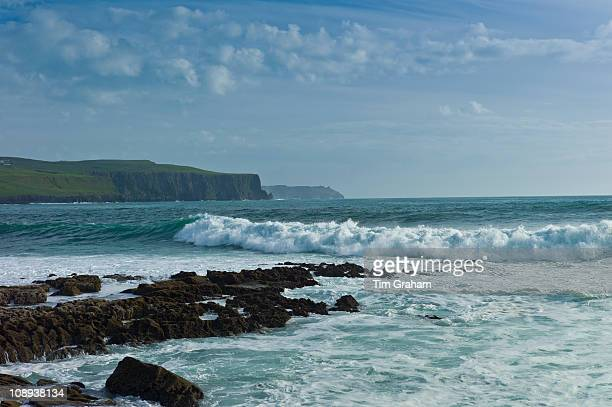 Cliffs of Moher and white horses waves and rocks from Doolin County Clare West Coast of Ireland