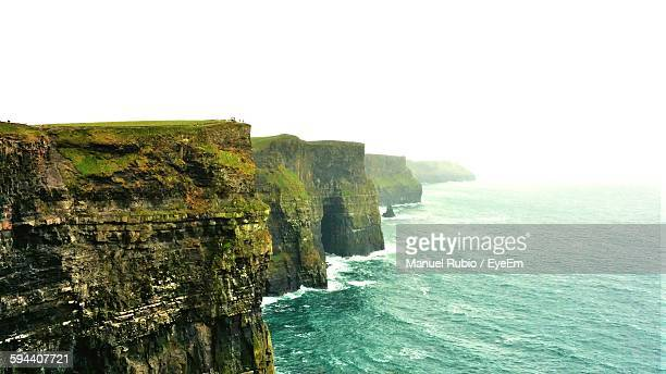Cliffs Of Moher By Sea Against Clear Sky