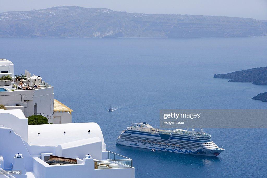 Cliffside houses and cruiseship AIDAdiva. : Stock Photo