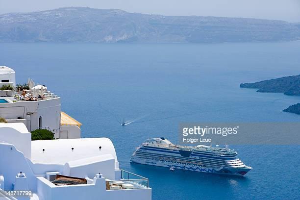 Cliffside houses and cruiseship AIDAdiva.