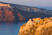Clifftop ruins at sunrise, Oia, Santorini, Greece