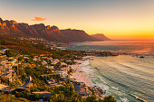 A wide picture of Clifton Beach in Cape Town, South Africa at late afternoon in a beautiful sunset. Colorful and satured taken with a Canon 6D.