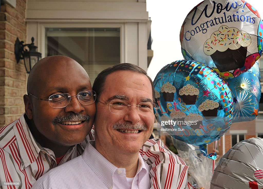 Clifton G. Scott, left, and Michael A. Williams pose for a photo on December 31, 2012, in Baltimore, Maryland. A couple for 29 years, Clifton and Michael will legally wed on New Year's Day.