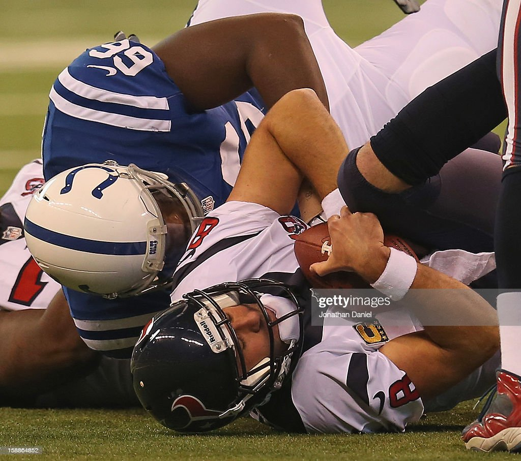 Clifton Geathers #66 of the Indianapolis Colts sacks <a gi-track='captionPersonalityLinkClicked' href=/galleries/search?phrase=Matt+Schaub&family=editorial&specificpeople=2210847 ng-click='$event.stopPropagation()'>Matt Schaub</a> #8 of the Houston Texans at Lucas Oil Stadium on December 30, 2012 in Indianapolis, Indiana. The Colts defeated the Texans 28-16.