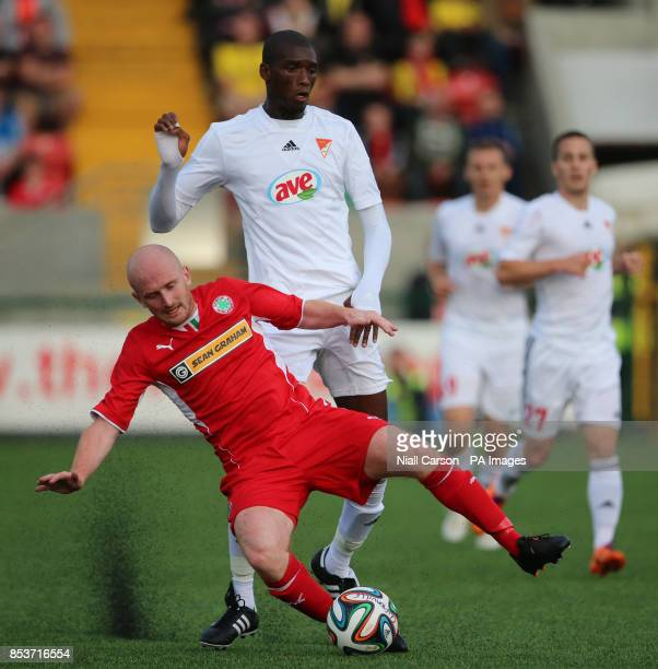 Cliftonville's Ryan Catney and Debrecen's Irahima Sidibe in action during the UEFA Champions League Qualifying match at Solitude Belfast