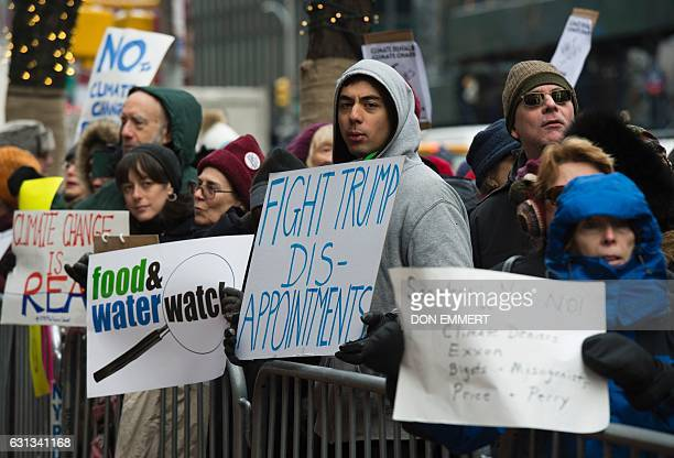 Climate activists rally to urge politicians to stand against climate denial and hate January 9 2017 in New York The protesters gathered as part of a...