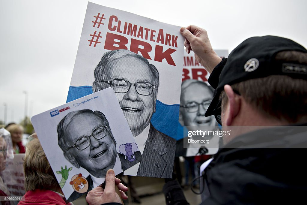 Climate change demonstrators hold signs in the likeness of Warren Buffett, chairman and chief executive officer of Berkshire Hathaway Inc., while protesting outside of the Berkshire Hathaway annual shareholders meeting in Omaha, Nebraska, U.S., on Saturday, April 30, 2016. Dozens of Berkshire Hathaway Inc. subsidiaries will be showing off their products as Chief Executive Officer Warren Buffett hosts the company's annual meeting. Photographer: Daniel Acker/Bloomberg via Getty Images