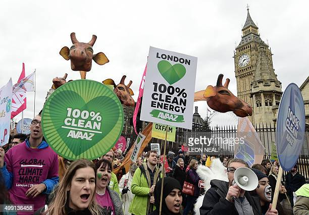 Climate change demonstrators march to demand curbs to carbon pollution in London on November 29 2015 on the eve of the climate summit in Paris...