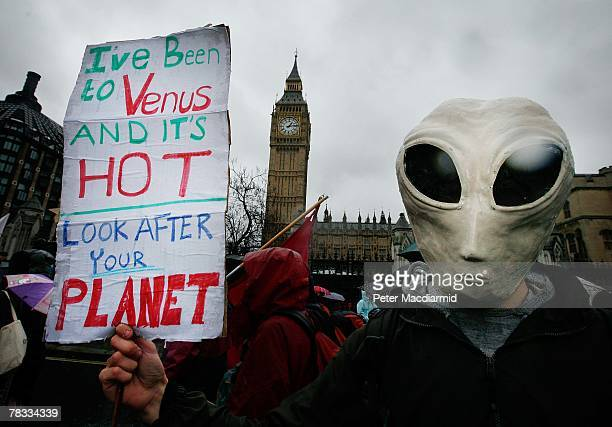 A climate change protestor walks near Parliament on December 8 2007 in London Demonstrators are gathering in more than 50 countries around the world...