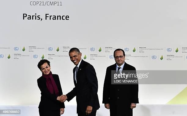 UN climate chief Christiana Figueres shakes hands with US President Barack Obama as French President Francois Hollande stands by upon his arrival for...