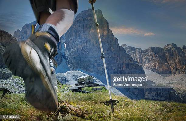 Climber arriving at a mountain's hut