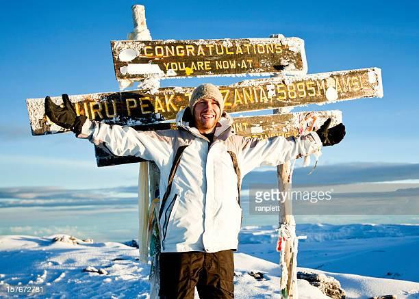 Climber at the Top of Mount Kilimanjaro
