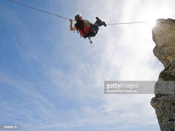 Climber crosses gap on Tyrolean Traverse