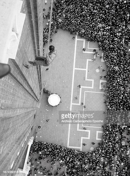 A climber descends St Mark's bell tower in 1966 in Venice Italy
