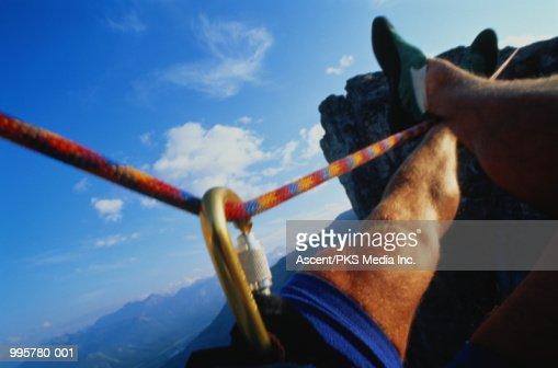 Backyard Pov At Night : Climber during tyrolean traverse between rocks, closeup