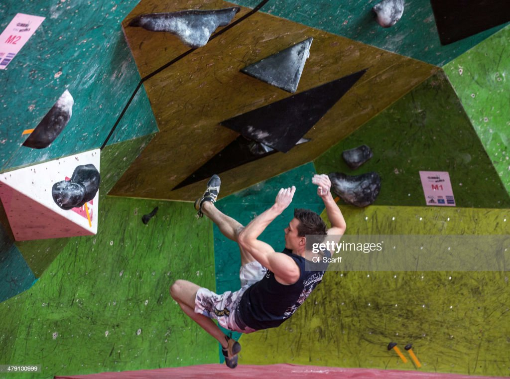 A climber falls as he takes part in the CWIF international bouldering competition on March 16, 2014 in Sheffield, England. The 'Climbing Works International Festival', now in its 8th year, attracts world-class climbers from around the world to Sheffield to compete on short, challenging climbs. Bouldering is climbing without the need for ropes or harnesses on typically short, challenging routes. The Climbing Works bouldering wall has over 1000 square meters of climbing surface featuring hundreds of boulder problems.
