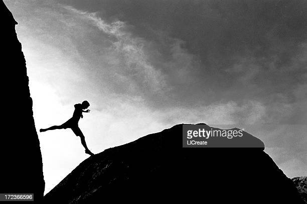 Climber Jumping from a Rock