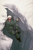 A climber learns selfrescue techniques for escaping glacial crevasses with the National Outdoor Leadership School Ptarmigan Traverse North Cascade...
