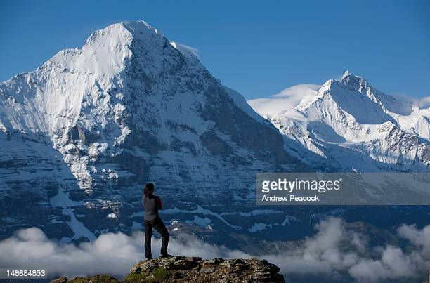Climber looks across to the notorious north wall of Eiger Mountain.