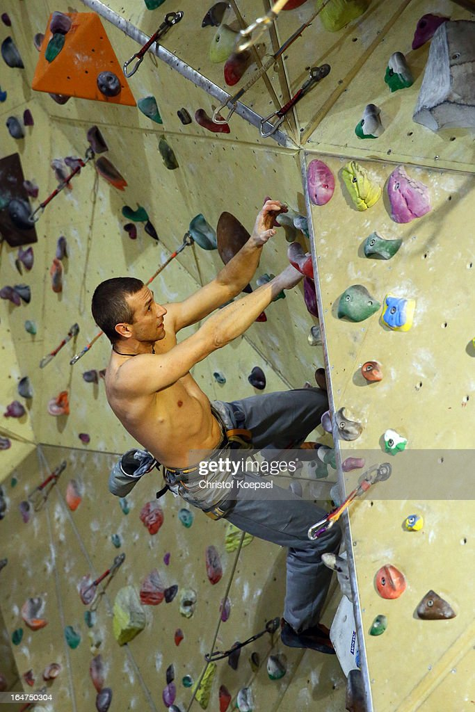 Climber Marc Weustermann climbs up the wall during the climping and bouldering at Wupperwaende Hall on March 27, 2013 in Wuppertal, Germany.