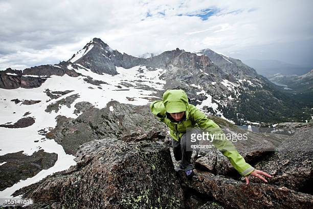 Climber on a Stormy Summit
