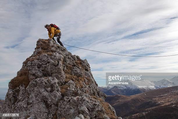 Climber reaches mountain summit