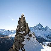 Climber reaches summit of snowy pinnacle