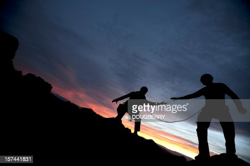 Climber reaching out to partner