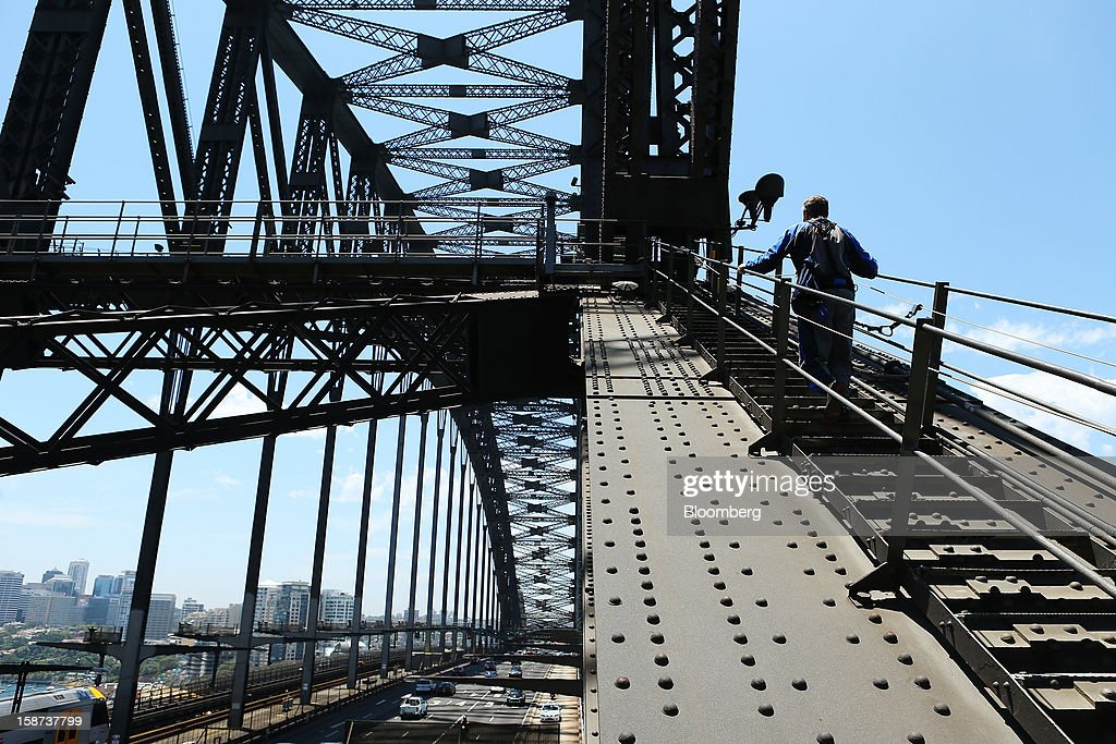 A climber scales the Sydney Harbour Bridge during a guided tour operated by BridgeClimb in Sydney, Australia, on Monday, Dec. 24, 2012. Beginning next month, people wanting to ascend 134 meters above sea level to the top of the bridge spanning Sydney Harbour will have the option to hear guides speak Mandarin. Photographer: Brendon Thorne/Bloomberg via Getty Images