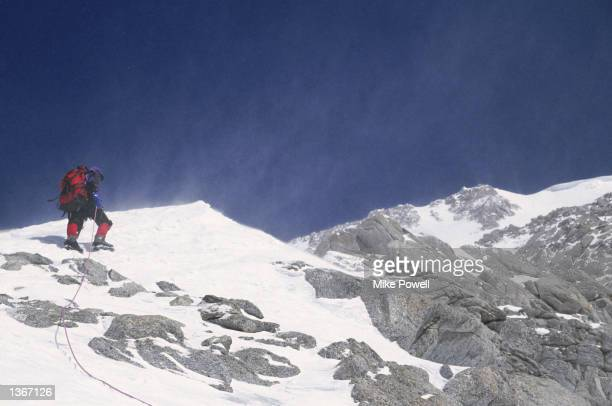 A climber stands on Windy Ridge near the summit of Mt McKinley in Denali National Park in Alaska