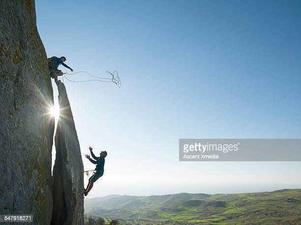 Climber throws rope lifeline to teammate