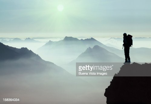 Climber watching a mountain ridge