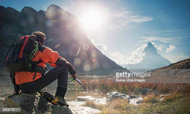 Climber watching Matterhorn from Riffelsee