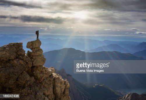 Climber watching mountain range
