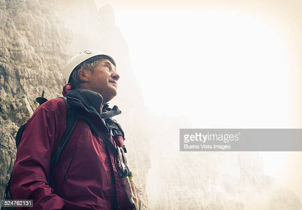 Climber watching mountains above