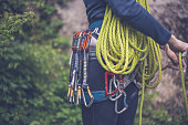 Climber with her equipment on belt