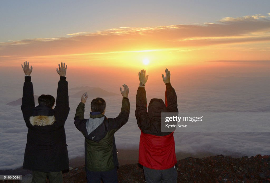 Climbers celebrate at the eighth station of Mt. Fuji as they face toward the sunrise at 4:36 a.m. on July 1, 2016, the first day of the climbing season for the 3,776-meter mountain. Straddling Shizuoka and Yamanashi prefectures in central Japan, Mt. Fuji is designated a UNESCO World Heritage site.